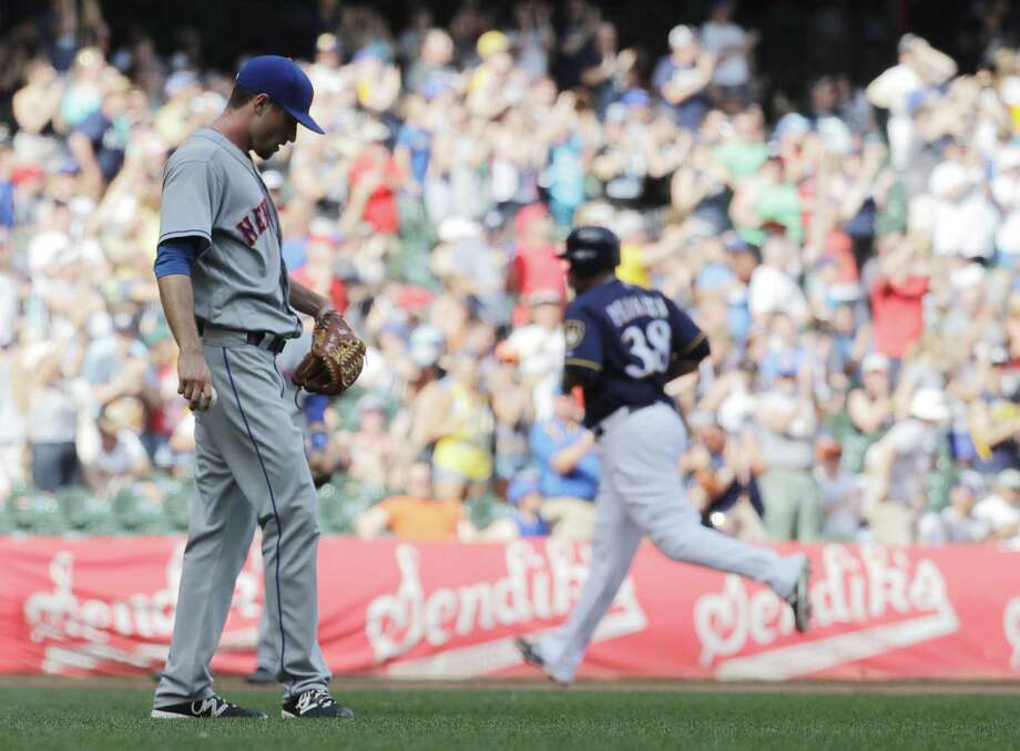 New York Mets relief pitcher Logan Verrett looks down after giving up a two-run home run to Milwaukee Brewers' Wily Peralta (38) during the fourth inning of a baseball game Saturday, June 11, 2016, in Milwaukee. (AP Photo/Morry Gash)  ORG XMIT: WIMG108 Photo: Morry Gash / AP