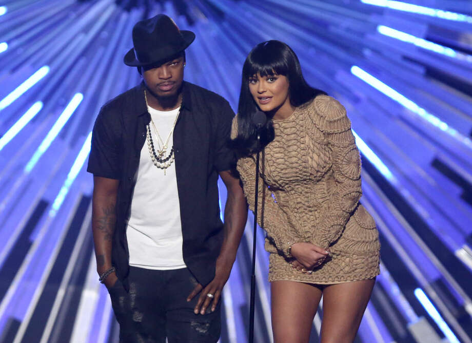 Ne-Yo, left, and Kylie Jenner introduce a performance by Tori Kelly at the MTV Video Music Awards at the Microsoft Theater on Sunday, Aug. 30, 2015, in Los Angeles. (Photo by Matt Sayles/Invision/AP)