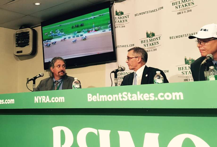 While a replay of the Belmont Stakes plays on in the background, the winners of the race meet the media at the press conference in the basement at Belmont Park early Saturday night. From left, are Steve Asmussen, the trainer of Creator, who nipped Destin at the wire, Kenny Troutt, owner of WinStar Farm, which owns Creator, and Elliott Walden, WinStar's president/CEO and racing manager. It didn't rain during the running of the Belmont, but it poured right after and, yes, Asmussen got soaked. Bet he didn't care. (Tim Wilkin / Times Union)