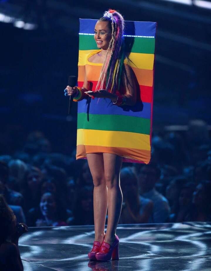 Host Miley Cyrus speaks at the MTV Video Music Awards at the Microsoft Theater on Sunday, Aug. 30, 2015, in Los Angeles. (Photo by Matt Sayles/Invision/AP)