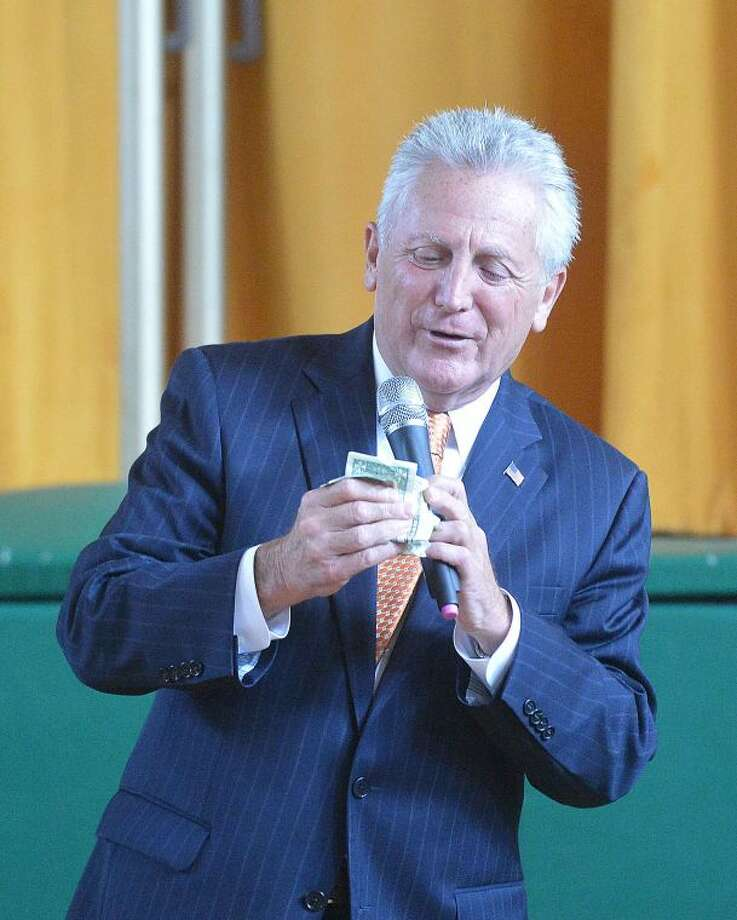 Hour Photo/Alex von Kleydorff Mayor Harry Rilling empties his wallet to make a donation to Coins for Cancer at Fox Run School on Monday