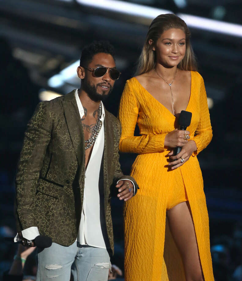 Miguel, left, and Gigi Hadid introduce a performance by 21 Pilots and A$AP Rocky at the MTV Video Music Awards at the Microsoft Theater on Sunday, Aug. 30, 2015, in Los Angeles. (Photo by Matt Sayles/Invision/AP)
