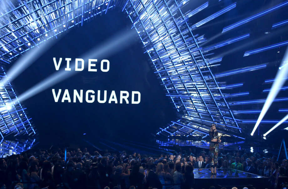Taylor Swift presents the video vanguard award at the MTV Video Music Awards at the Microsoft Theater on Sunday, Aug. 30, 2015, in Los Angeles. (Photo by Matt Sayles/Invision/AP)