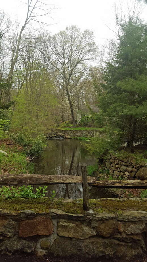 Aquarion wants to sell off 19 acres upriver from this bridge on Indian Waters Drive in New Canaan. Photo: Thane Grauel / Hearst Connecticut Media / Darien News