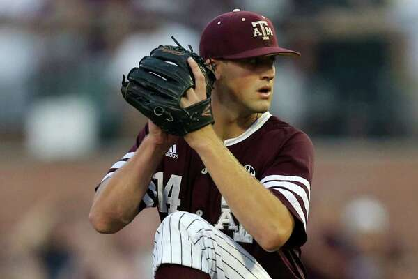 Texas A&M's Kyle Simonds winds up during the first inning of an NCAA college baseball tournament super regional game against TCU on Saturday, June 11, 2016, in College Station, Texas. (AP Photo/Sam Craft)