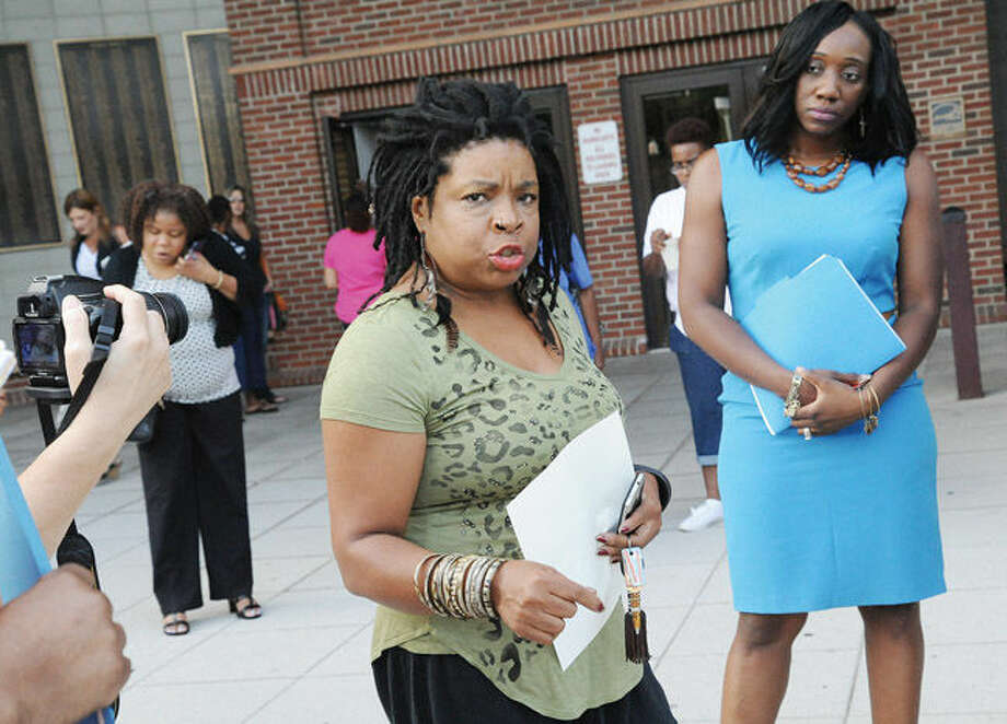Angela Harrison Norwalk resident and petition supporter along with Chiquita Stephanson former NEON CEO and President speaks Tuesday night at Norwalk City Hall before the Board of Education meeting where supporters of Shirly Mosby are aking for the resignation of two Board of Education members. Hour photo/Matthew Vinci