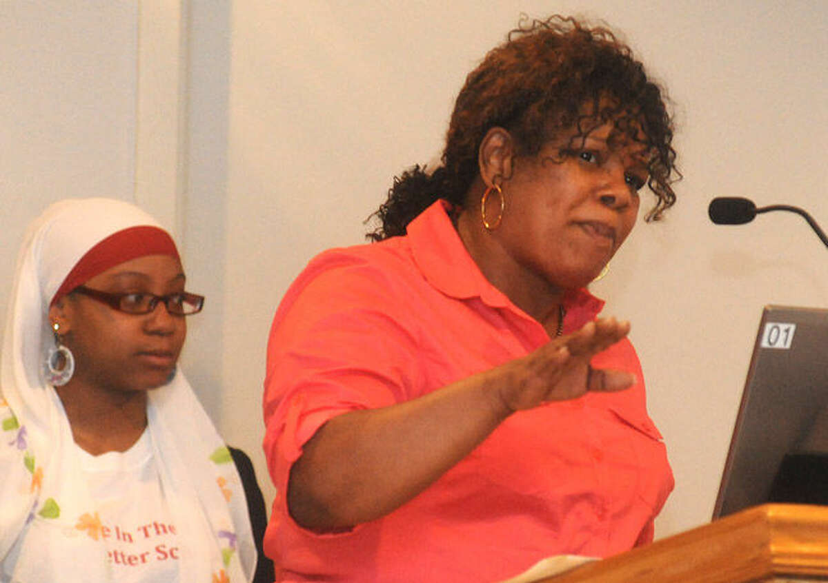 Gwen Samuel with the Connecticut Parents Union speaks out Tuesday night at Norwalk City Hall calling on the resignation of two Board of Education members. Hour photo/Matthew Vinci