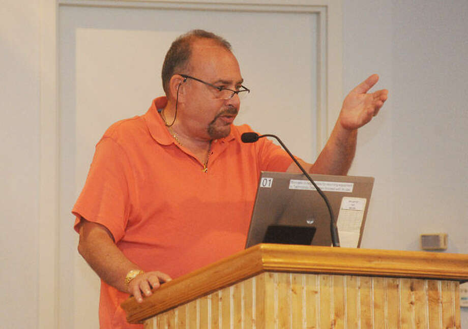 Norwalk resident John Romano speaks out Tuesday night to call for understanding and not to misunderstand comments from a board of education member and the call from some residents to have him resign. Hour photo/Matthew Vinci