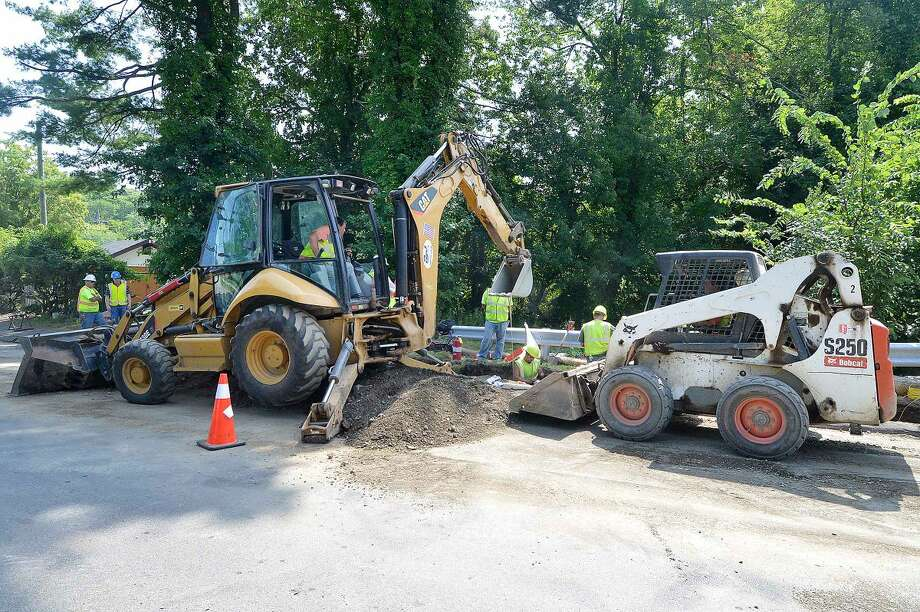 Hour Photo/Alex von Kleydorff Work continues on installing the new gas line in in Wilton with crews on School Rd on Wednesday