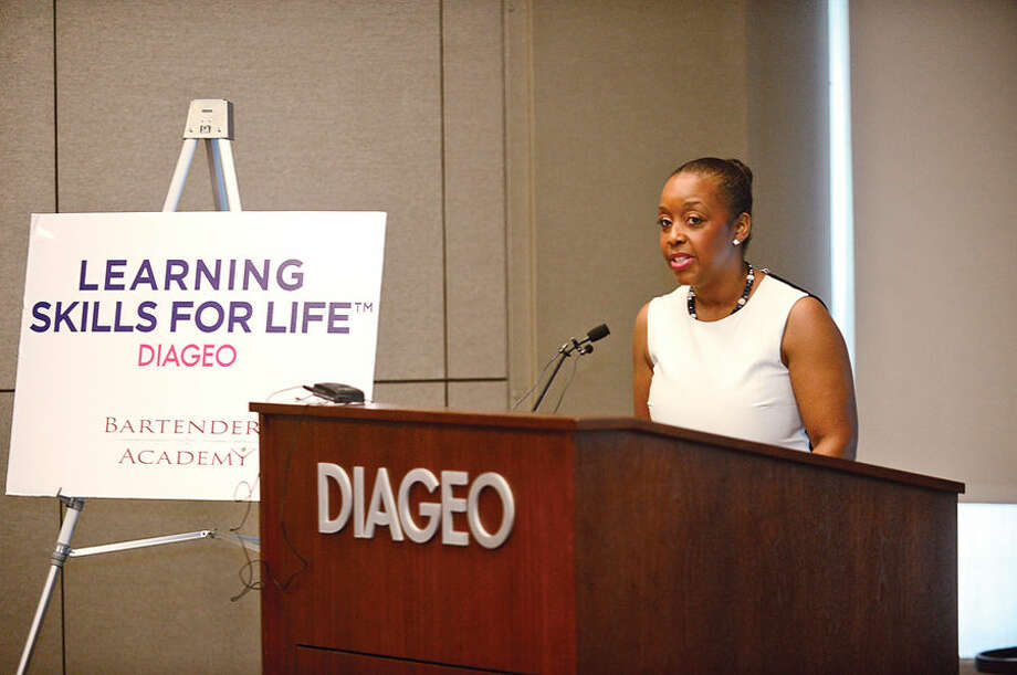 Hour photo / Erik Trautmann Diageo Alchohol Policy Director Danielle Robinson addresses the graduates as Diageo's Hospitality Training Program, Learning Skills for Life, graduates 13 women during a ceremony at Diageo headquarters in Norwalk Wednesday.