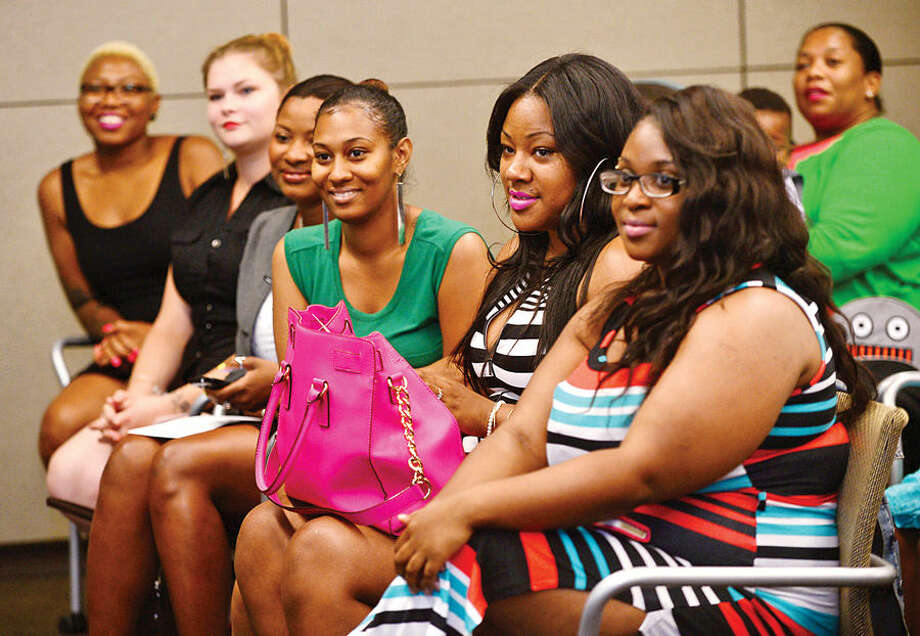 Hour photo / Erik Trautmann Diageo's Hospitality Training Program, Learning Skills for Life, graduates 13 women during a ceremony at Diageo headquarters in Norwalk Wednesday.