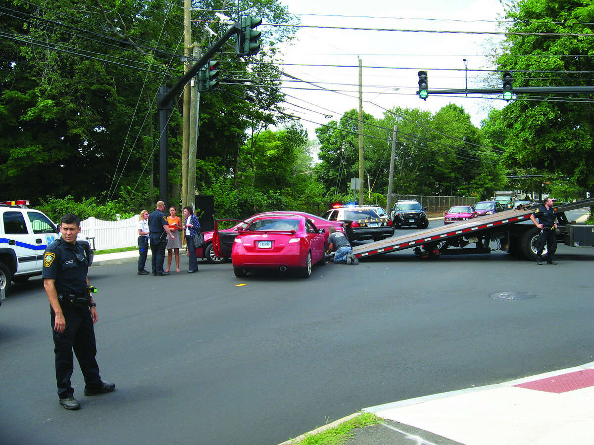 Contributed photo A car accident on the corner of Norden Place and Strawberry Hill Avenue sent at least two people to the hospital and temporarily closed the intersection Wednesday afternoon.