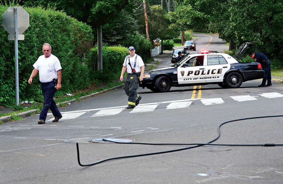 Hour photo / Erik Trautmann Stuart Ave is closed Wednesday afternoon at Truman St due to downed live electrical wires.