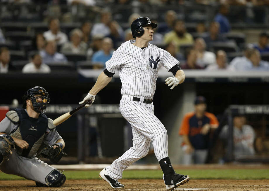 New York Yankees Chase Headley watches his fifth-inning, solo home run off Detroit Tigers starting pitcher Justin Verlander in a baseball game at Yankee Stadium in New York, Wednesday, Aug. 6, 2014. (AP Photo/Kathy Willens)