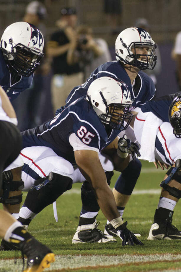 Steve Slade/UConn AthleticsGus Cruz (65) lines up before a play last season.