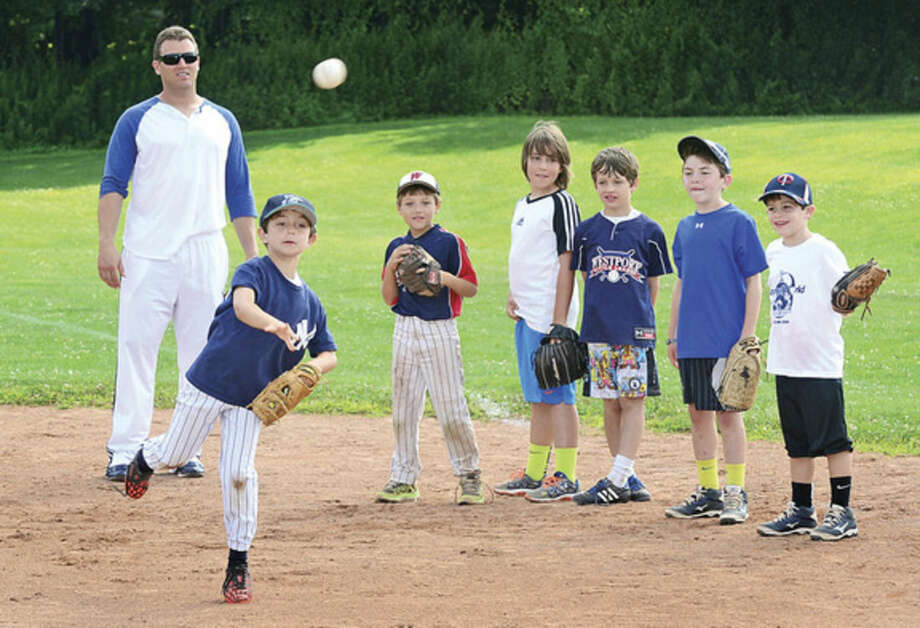 Hour photo / Erik TrautmannSean Burroughs works with campers at Baseball World camp in Westport Wednesday.