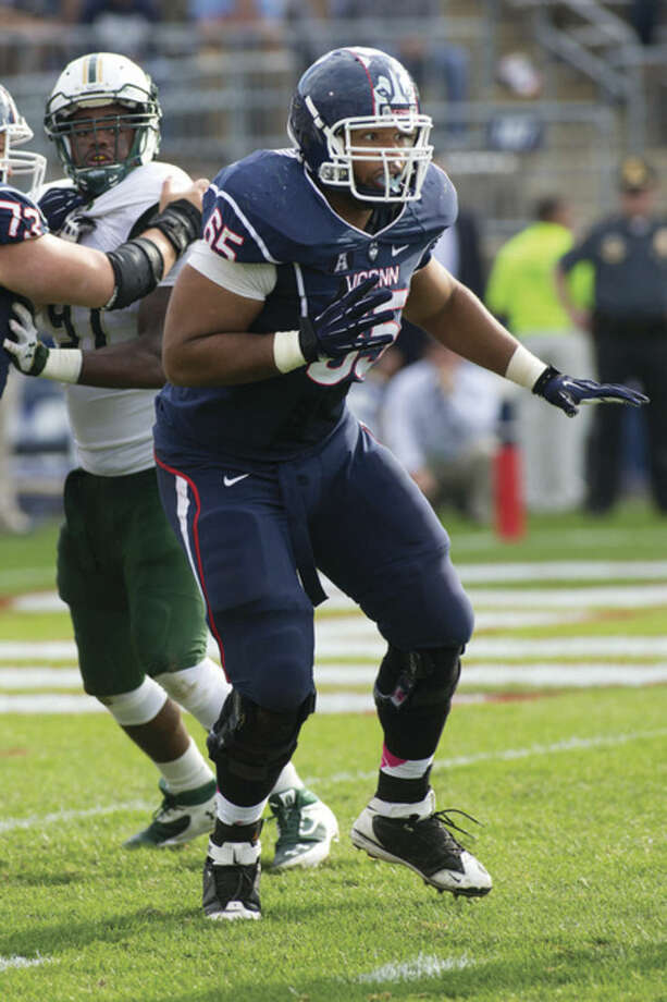 Steve Slade/UConn AthleticsUConn offensive lineman Gus Cruz looks for someone to block during a game last season.