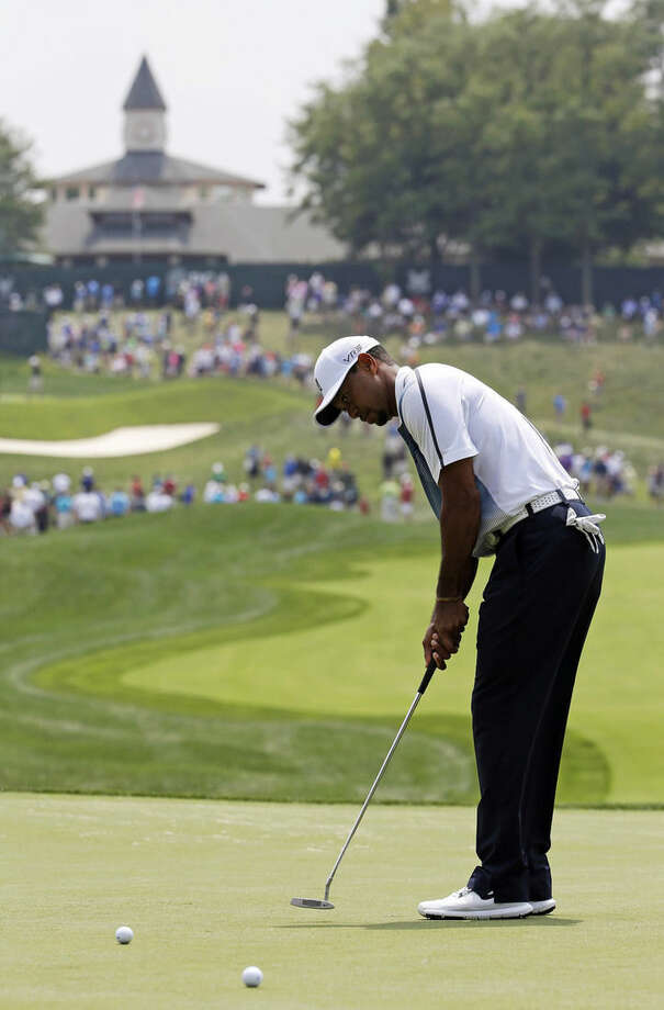 Tiger Woods putts on the first hole during a practice round for the PGA Championship golf tournament at Valhalla Golf Club on Wednesday, Aug. 6, 2014, in Louisville, Ky. The tournament is set to begin on Thursday. (AP Photo/David J. Phillip)