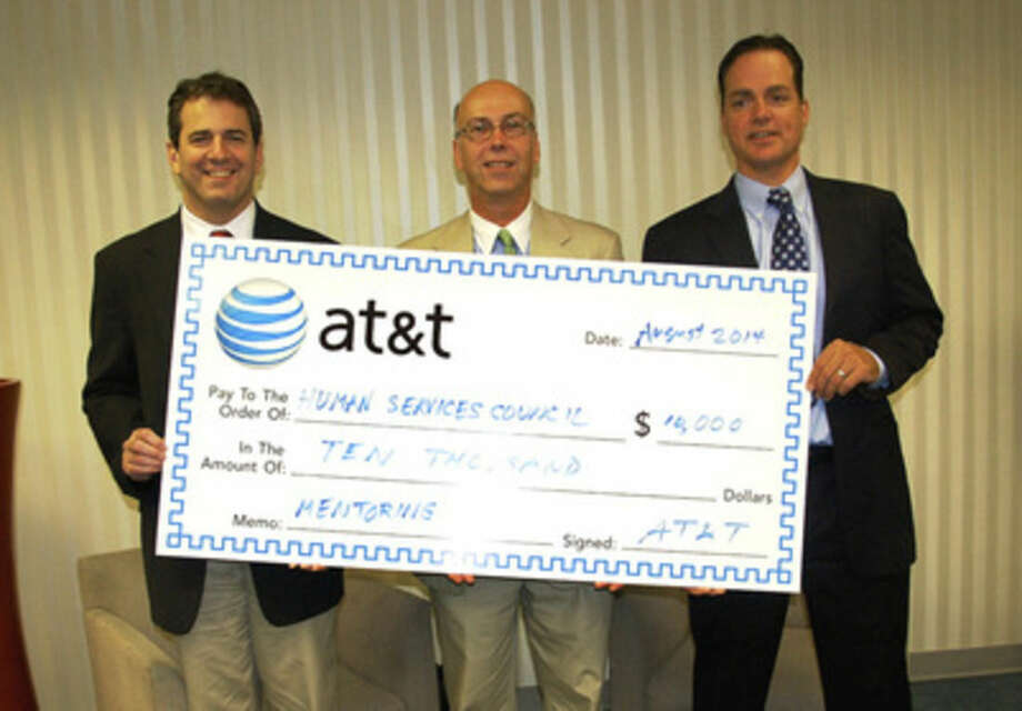 Contributed photoState Rep. Chris Perone, D-137; Harry Carey, director of External Affairs AT&T Connecticut; and Anthony DiLauro, executive director of the Human Services Council, pose for a photo with a ceremonial check.