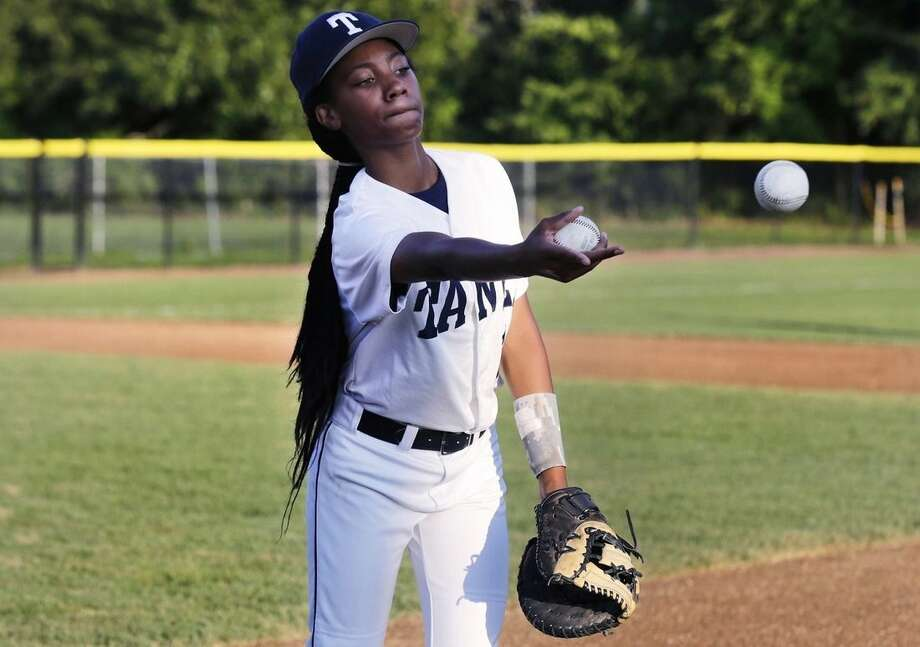 In this Aug. 6, 2014, photo, Pennsylvania's Mo'Ne Davis flips baseballs to a teammate prior to facing the District of Columbia in the Little League Eastern Regionals at Breen Stadium in Bristol, Conn. Davis and New Jersey's Kayla Roncin are competing to make it to the Little League World Series, a rare feat for girls. (AP Photo/Charles Krupa)