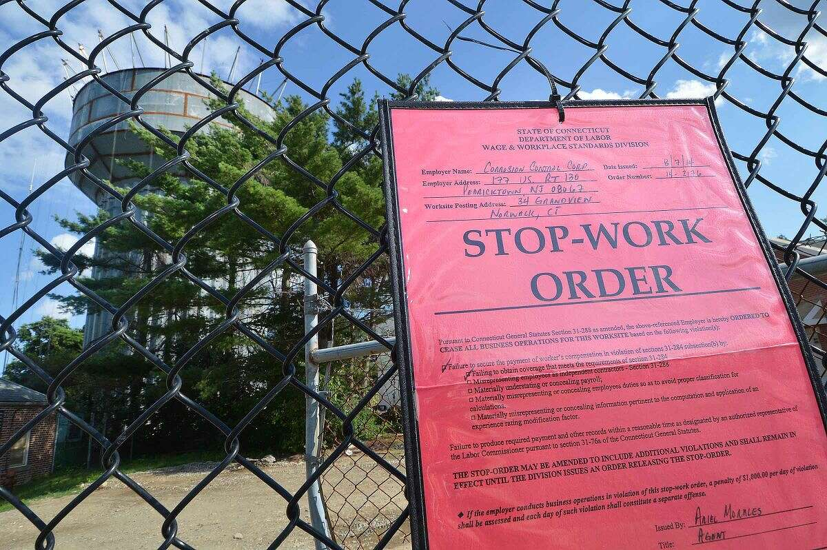 Hour Photo/Alex von Kleydorff Stop Work Order posted on the fence of the water tower construction site on Grandview Ave. on Thursday