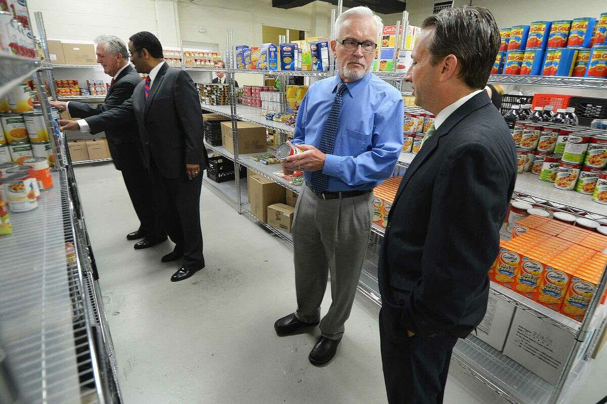 Hour Photo/Alex von Kleydorff State Rep Bruce Morris. Mayor Harry Rilling, State Sen. Bob Duff, Executive Executive Director CHEFA Jeffrey Asher, Mayor Harry Rilling and State Rep. tour the food pantry at Person to Person.