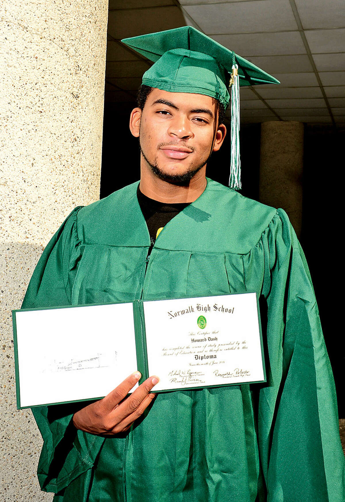 Hour photo / Erik Trautmann Howard Dash, who recently graduated from Norwalk High School this summer learned that the school will not hold a graduation ceremony.