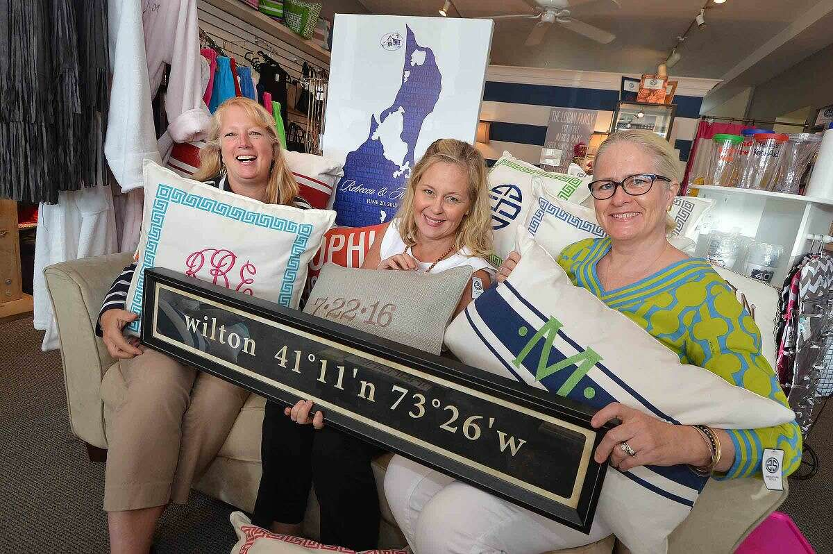 Carol Rowe, Ann Nash and Mary Logan of Signature Style in Wilton Center display some of their personalized goods.