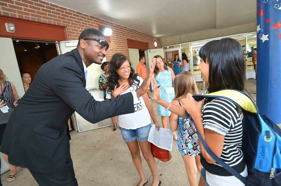 Hour Photo/Alex von Kleydorff Principal Dr. Albert Sackey greets all the students back to Nathan Hale Middle School on Monday morning