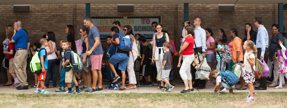Hour photo/Chris Palermo. Parents and students line up for the first day of school at Naramake Elementary Monday morning.