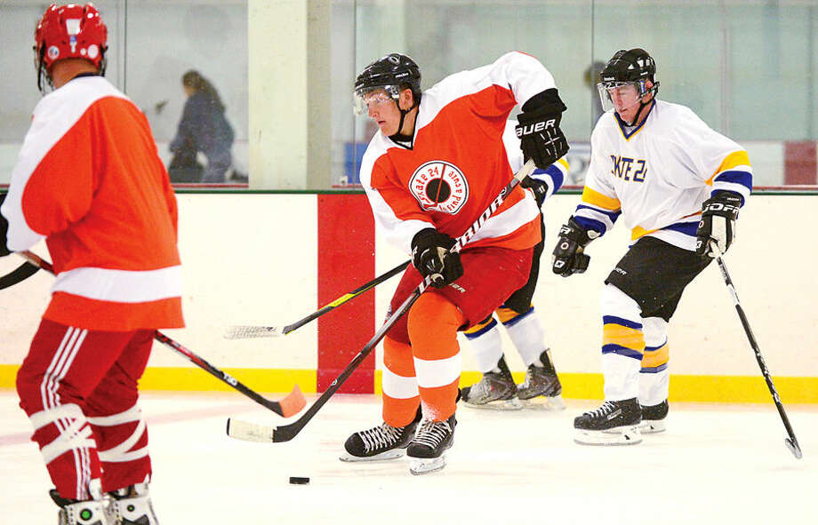 Hour photo / Erik Trautmann Skaters including Orange Team 2 player Grant Hazel take part in Skate to Find a Cure, a 24-hour hockey game at SoNoIce House.