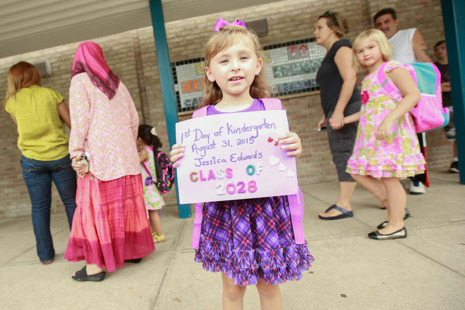Hour photo/Chris Palermo. Jessica Edwards shows off her sign for the first day of school at Naramake Elementary Monday morning.