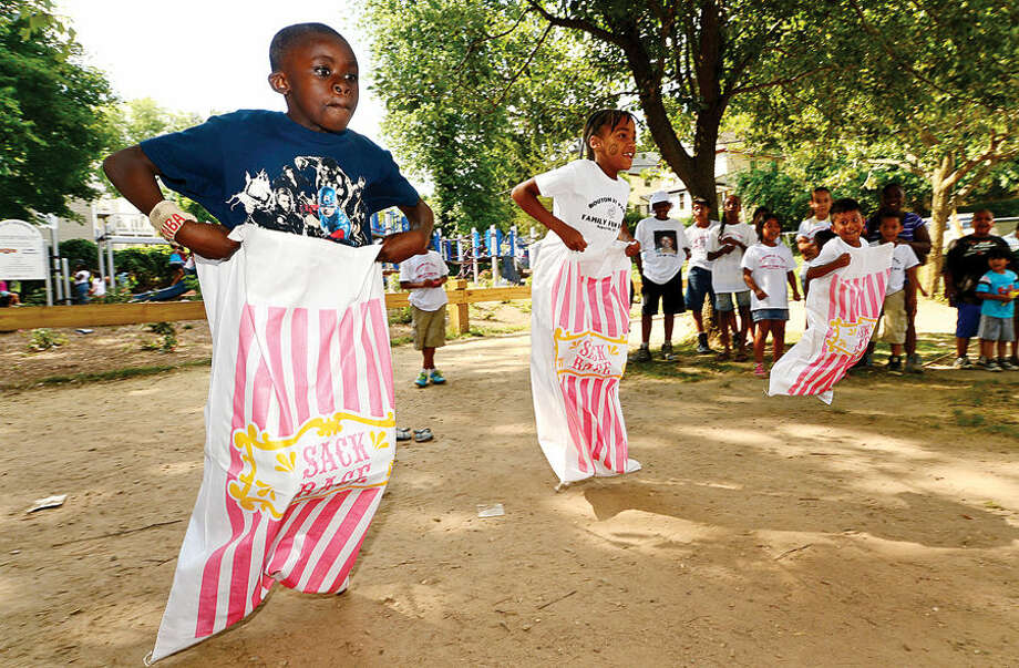 Hour photo / Erik Trautmann Jamar Alcena, 9, particpates in the sack race during the Bouton St. Back to School Block Party Saturday.