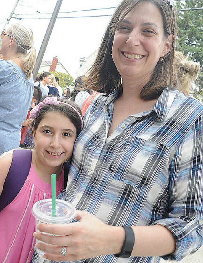 Loraine Masone with her daughter Sophia on the first day of school at K.T. Murphy school in Stamford. Photo/Matthew Vinci
