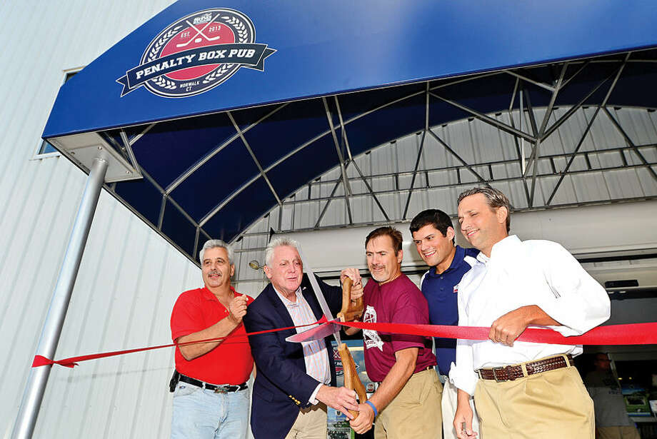 Hour photo / Erik Trautmann Rick Tavella, Mayor Harry Rilling Penalty Box Pub owner Bill Lengyel, SoNo Ice House president Ryan Hughes and State Senator Bob Duff (D-25) attend the ribbon cutting ceremony for the Penalty Box Pub at the SoNo Ice House Saturday.