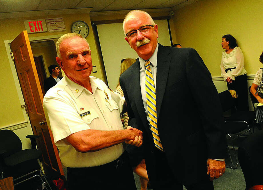Fairfield Fire Chief Richard Felner with Denis McCarthy at the Fairfield Fire Commision meeting. McCarthy was appointed to replace Felner Monday night. Hour photo/Matthew Vinci
