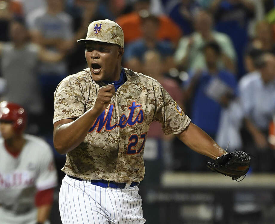 New York Mets relief pitcher Jeurys Familia (27) reacts after striking out Philadelphia Phillies' Andres Blanco in the ninth inning to win the baseball game 3-1 at Citi Field on Monday, Aug. 31, 2015, in New York. (AP Photo/Kathy Kmonicek)