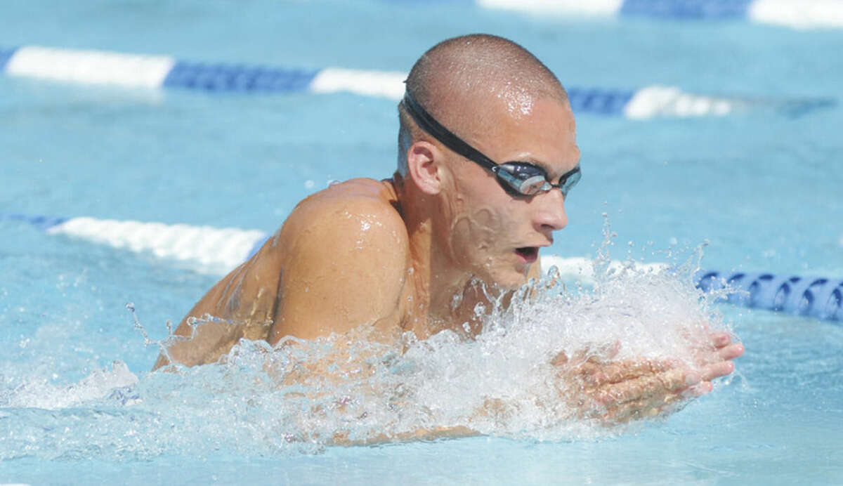 Hour photo/John Nash Stephen Holmquist of Shore and Country Club powers through the water during the boys 17-and-under 50-yard breaststroke at Saturday's Fairfield County Swim League championship meet in Stamford.