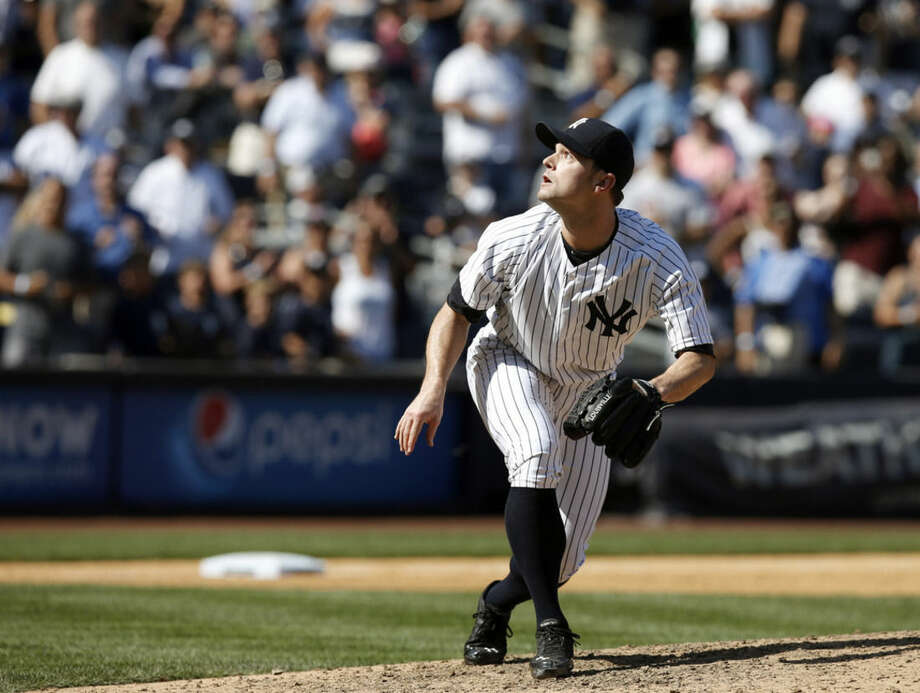 New York Yankees relief pitcher David Robertson (30) watches as Don Kelly's ninth-inning pop out sails over his head for the final out in the Yankees 1-0 defeat for the Tigers in a baseball game at Yankee Stadium in New York, Thursday, Aug. 7, 2014. (AP Photo/Kathy Willens)