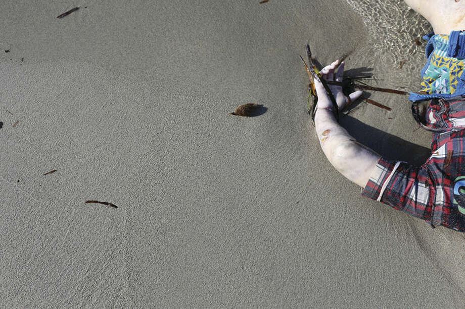 AP photo/Mohamed Ben KhalifaThe body of a child, who washed up along with others, is seen in Zuwara, Libya (65 miles west of Tripoli) after two smuggling boats sank off the coast of Libya last Thursday. More than 2,000 migrants have drowned this year, including 200 last week, chiefly when trying to reach Italy's southernmost islands from Libya.