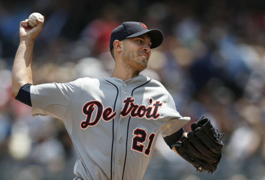 Detroit Tigers starting pitcher Rick Porcello delivers in the first inning of a baseball game against the New York Yankees at Yankee Stadium in New York, Thursday, Aug. 7, 2014. (AP Photo/Kathy Willens)