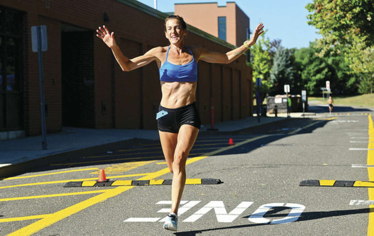 Hour photo / Erik Trautmann Wilton's Mary Zengo breaks the course recond for women with a time of 1:03:25 in the Westport Road Runners Summer Series 10-mile race on Saturday at Staples High School.