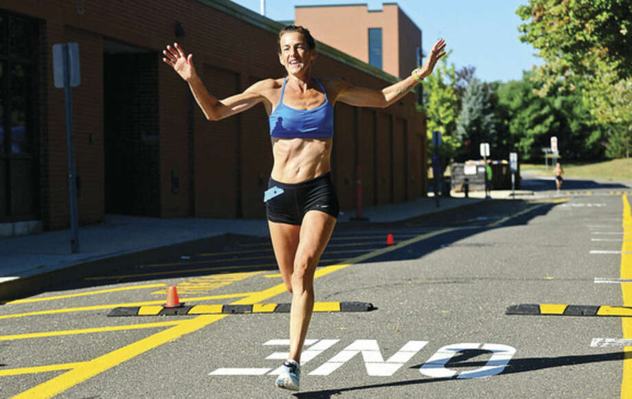 Hour photo / Erik TrautmannWilton's Mary Zengo breaks the course recond for women with a time of 1:03:25 in the Westport Road Runners Summer Series 10-mile race on Saturday at Staples High School.