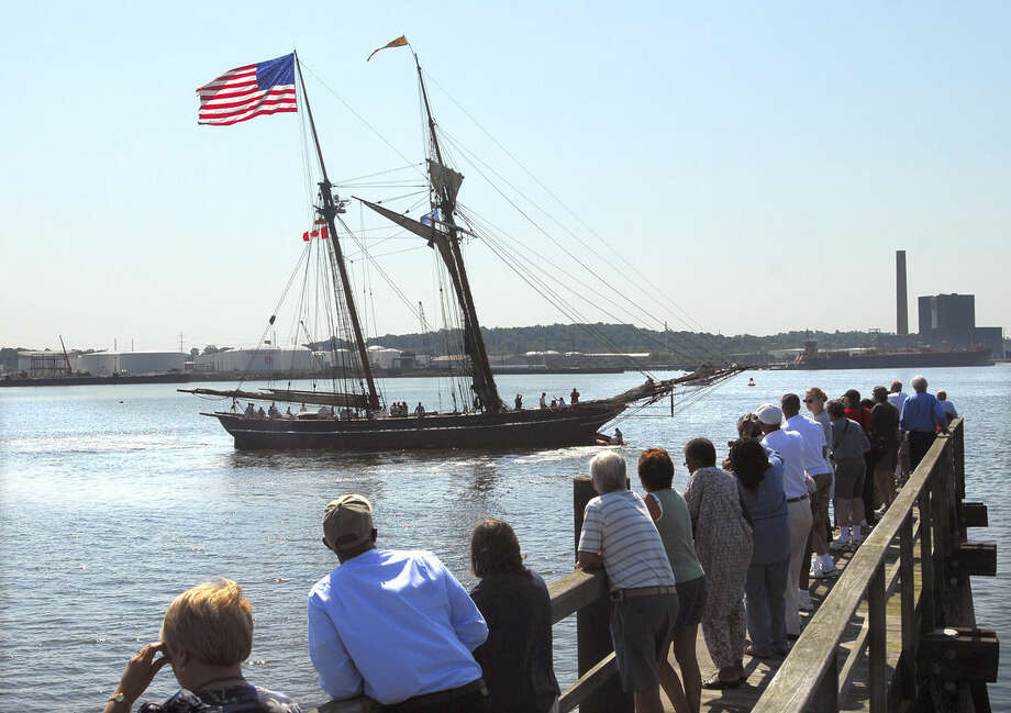 In this June 21, 2008 photo, a crowd watches the replica schooner Amistad returning home to New Haven, Conn., after a yearlong world tour. The replica ship serves as a symbol of America's early anti-slavery movement. Enslaved Africans aboard the original Spanish ship named Amistad revolted in 1839, seizing it and sailing up the East Coast. (Peter Casolino/New Haven Register via AP) MANDATORY CREDIT