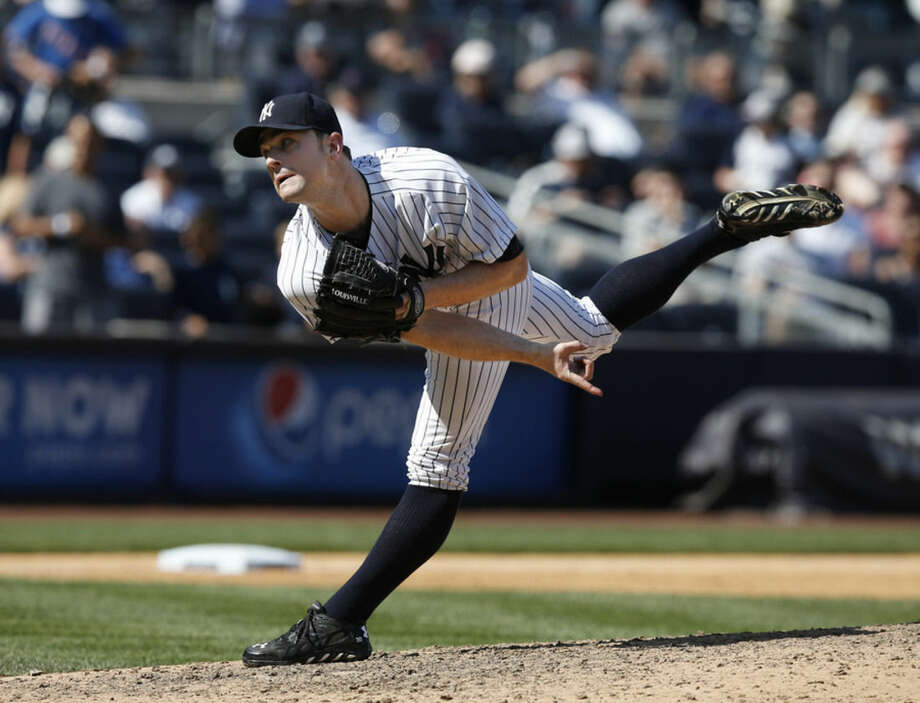 New York Yankees relief pitcher David Robertson (30) follows through on a ninth-inning pitch in a baseball game against the Detroit Tigers at Yankee Stadium in New York, Thursday, Aug. 7, 2014. Robertson earned the save as the Yankees defeated the Tigers 1-0. (AP Photo/Kathy Willens)