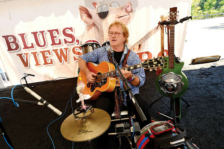 Hour photo / Erik Trautmann Dan Stevens plays a blues song during the 8th annual Blues, Views and BBQ Festival at Westport's Levitt Pavilion Saturday.