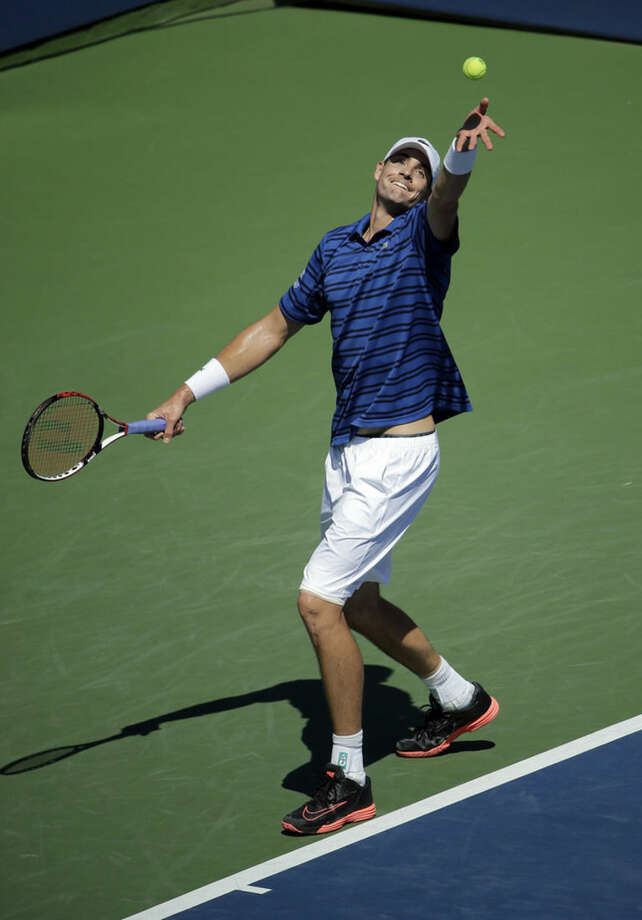 John Isner, of the United States, serves to Jiri Vesely, of the Czech Republic, during the third round of the U.S. Open tennis tournament, Saturday, Sept. 5, 2015, in New York. (AP Photo/Matt Rourke)