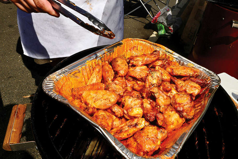 Hour photo / Erik Trautmann Chicken wings ready for judging during the 8th annual Blues, Views and BBQ Festival at Westport's Levitt Pavilion Saturday.