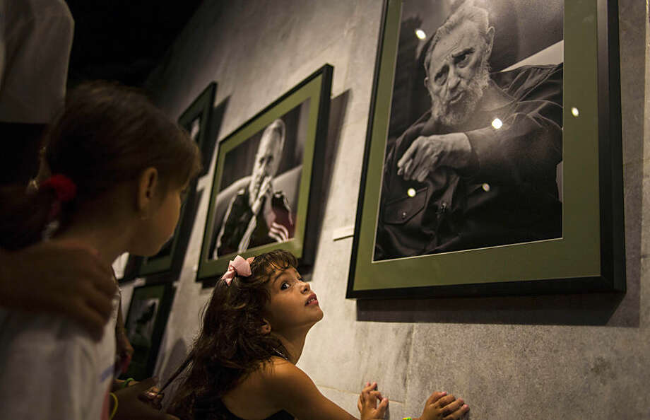 A girl attends an exhibition of photographs of Fidel Castro by photographer Roberto Chile at the Jose Marti Memorial in Havana, Cuba, Tuesday, Aug. 12, 2014. Castro will celebrate his 88th birthday on Wednesday. (AP Photo / Ramon Espinosa)