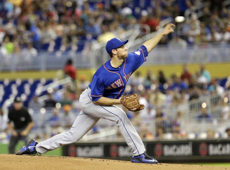 New York Mets' Steven Matz pitches against the Miami Marlins in the first inning of a baseball game, Sunday, Sept. 6, 2015, in Miami. (AP Photo/Alan Diaz)